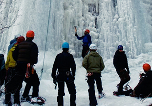 group of climbers waiting to ice climb